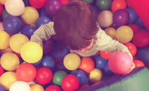 Ball pit child